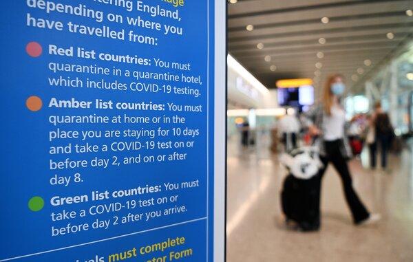 Signs at Heathrow Airport explaining Britain's quarantine requirements.