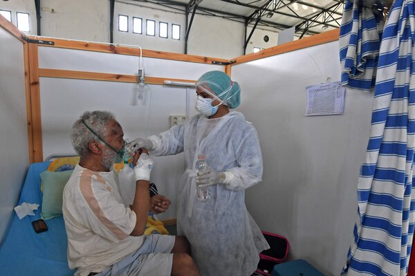 Attending to a patient in Kairouan, Tunisia, earlier this month.