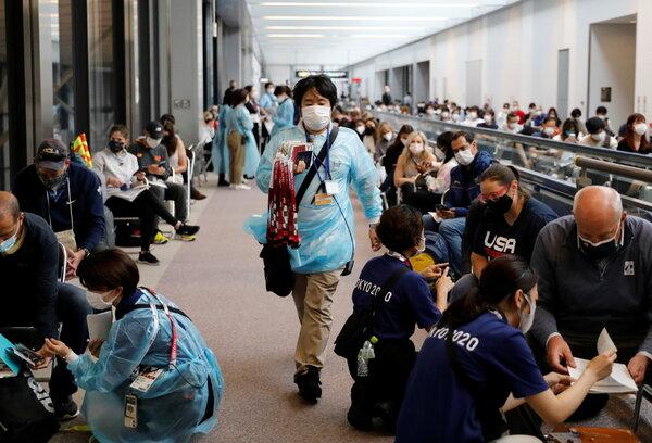 Officials preparing to administer coronavirus tests to members of the U.S. gymnastics team at Japan's Narita International Airport on Thursday.