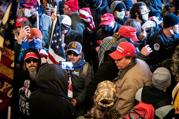 The mob that stormed the Capitol in January. Ashli Babbitt, who was fatally shot by a police lieutenant, was among a throng that began smashing into a hallway off the House floor while officers were evacuating lawmakers from the chamber.